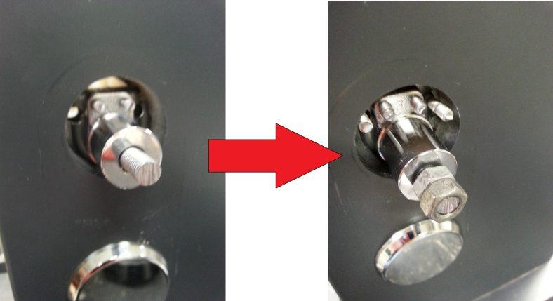 Pultin ja avainpesän rungon yhdistelmä ruuvattuna kiinni oveen, ja pultin päähän kiinnitetyt mutterit.